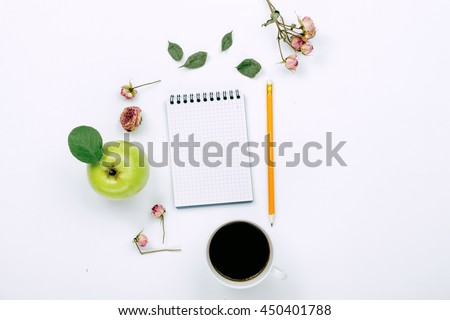 Cup of black coffee, sketchbook with pencil and dry rose flowers. Flat lay, top view - stock photo