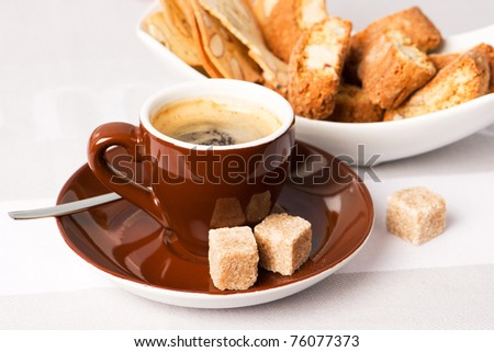 cup of black coffee with Italian almond cookies cantuccini