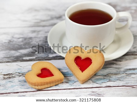 Cup of black tea and heart shaped cookies, for valentine's day