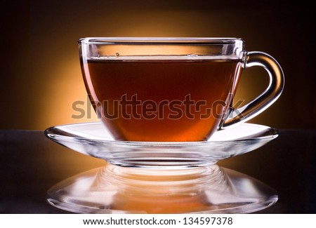 Cup of black tea isolated on a black background - stock photo