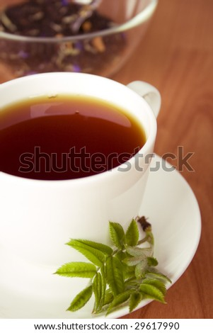 cup of black tea with herbs