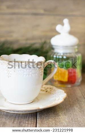 Cup of black tea with lemon and sweets on the table