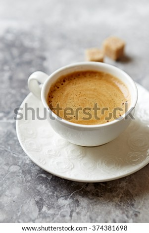 Cup of cafe crema on a stone background - stock photo