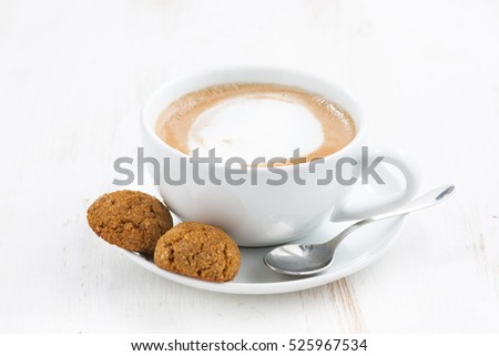 cup of cappuccino and flavored cookies, horizontal