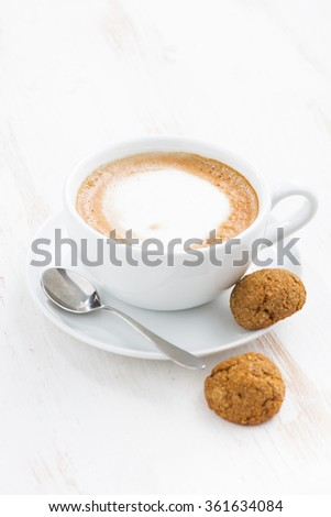 cup of cappuccino and macaroons, vertical, top view