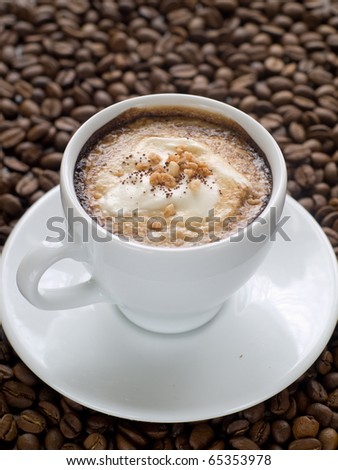 Cup of Cappuccino coffee on a wood table with cookies