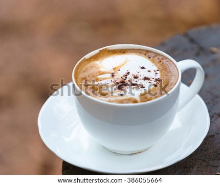 Cup of Cappuccino on wooden  table with chocolate - stock photo