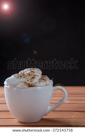 Cup Of Cappuccino Over Wooden Table, Black Background. - stock photo