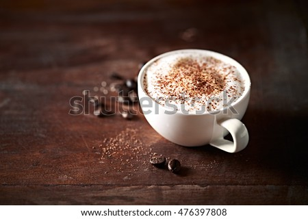 Cup of Cappuccino topped with Cocoa