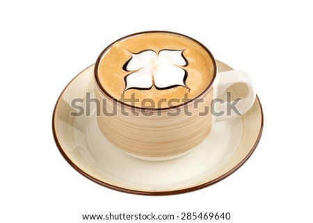 cup of cappuccino with artistic cream decoration - stock photo