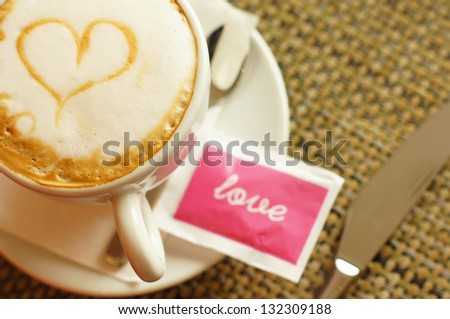 Cup of cappuccino with heart sign - stock photo