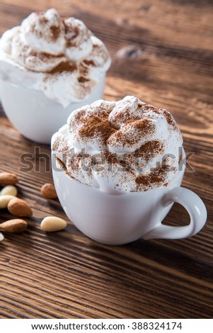 Cup Of Cappuccino With Whipeed Cream Over Wooden Table. - stock photo