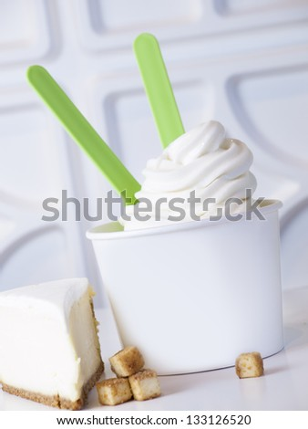 Cup of cheesecake frozen yogurt or soft serve ice cream. - stock photo