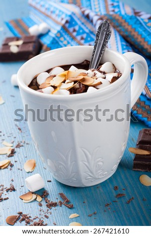 Cup of chocolate milk made from almond milk with marshmallow and almond chips. Selective focus - stock photo