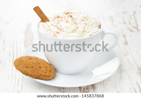 cup of cocoa with cinnamon, whipped cream and oatmeal cookies, close-up - stock photo