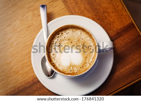 cup of cofee from top with heart on the foam, copy space - stock photo