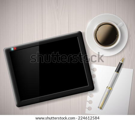 cup of coffee and a digital tablet on the table - stock photo