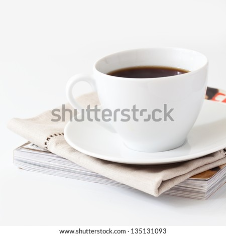 Cup of coffee and a magazine