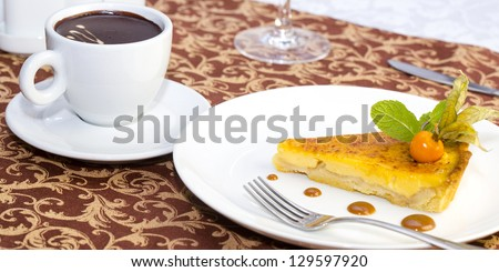 cup of coffee and a piece of cake on the table