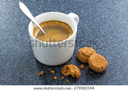 cup of coffee and almond biscuits on a dark background, top view - stock photo