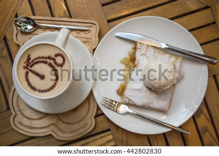 Cup of coffee and apple strudel with ice cream - stock photo