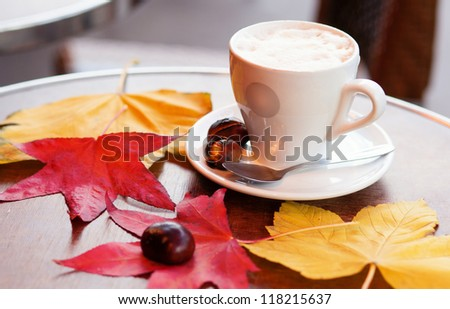 Cup of coffee and baked chestnuts