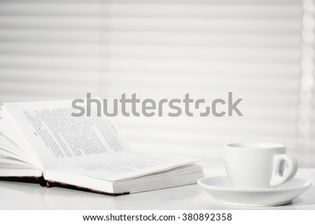 Cup of coffee and book - stock photo