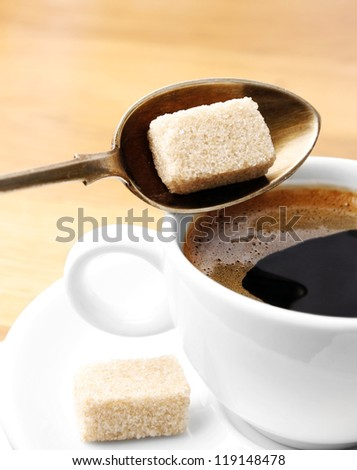 Cup of coffee and brown sugar - stock photo
