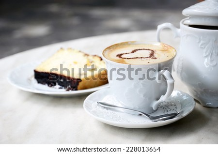 Cup of coffee and cake in cafe - stock photo