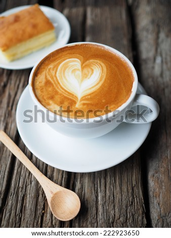 cup of coffee and cake in coffee shop vintage color - stock photo