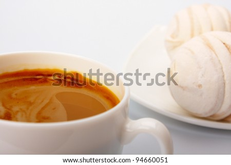 Cup of coffee and cakes on white