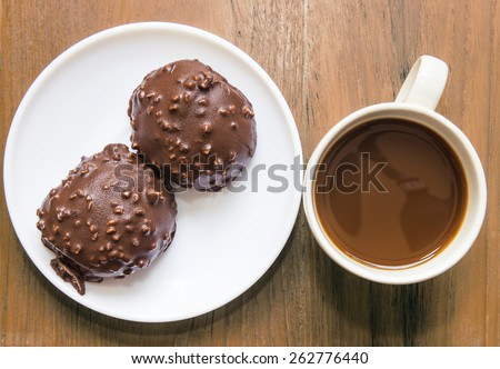 cup of coffee and  chocolate ball - stock photo
