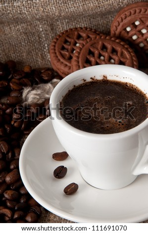 cup of coffee and chocolate cookies