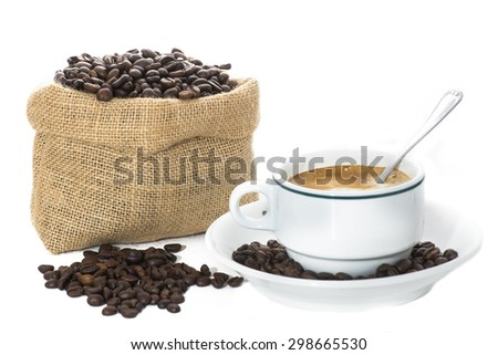 Cup of coffee and coffee beans in sack isolated