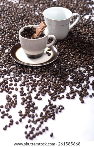 Cup of coffee and coffee beans with chocolate - stock photo
