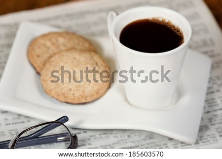 Cup of coffee and cookies. - stock photo