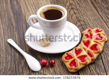 Cup of coffee and cookies with jam and cranberry