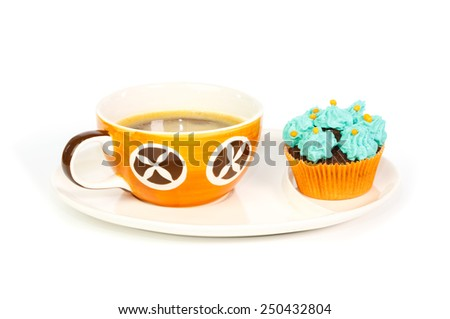 Cup of coffee and cupcake with blue rosettes of cream frosting against white background - stock photo