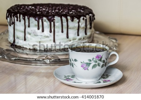 Cup of coffee and delicious chocolate cake with creamy cream  - stock photo