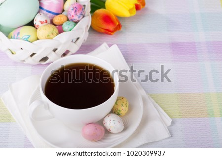 Cup of coffee and Easter candy and eggs with copy space