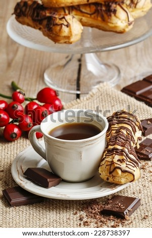 Cup of coffee and eclairs