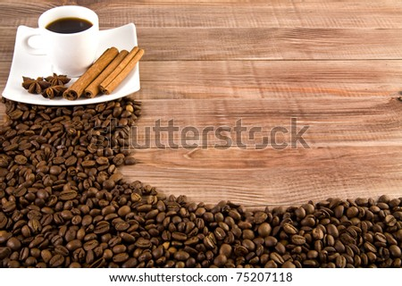 cup of coffee and grain on a wooden table