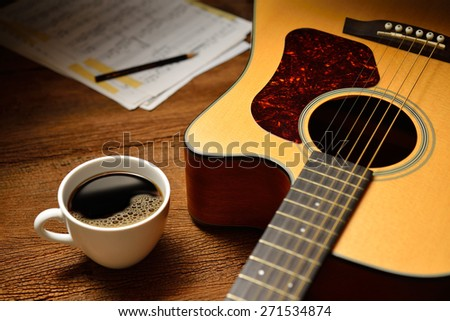 coffee cup guitar on wooden table stock photo 127144130 - shutterstock