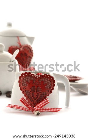 Cup of coffee and handmade heart of fabric on Valentine's Day - stock photo