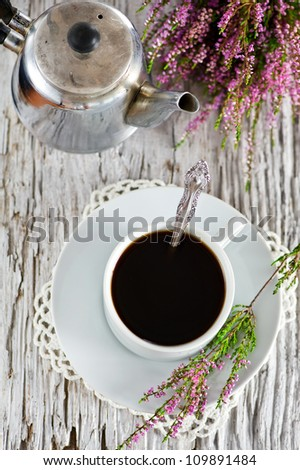 Cup of coffee and heather - stock photo