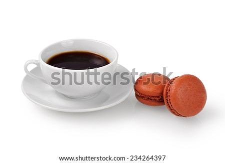 Cup of coffee and macarons isolated on white background