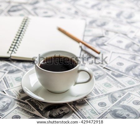 Cup of coffee and open book, focus a cup - stock photo