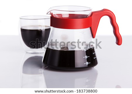 Cup of coffee and pour-over. Shallow dof. - stock photo