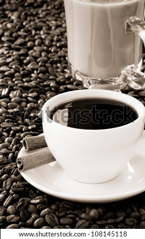 cup of coffee and roasted beans as background - stock photo