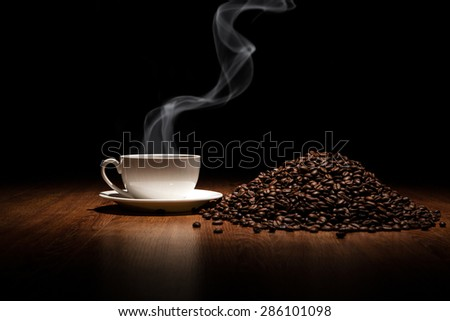 cup of coffee and roasted beans close up - stock photo